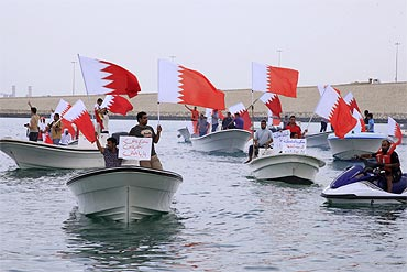 Anti-government fishermen protest in their boats around the shore of Manama