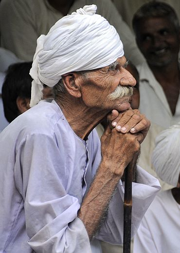 A member of the Jat community listen to a speech during a protest in New Delhi