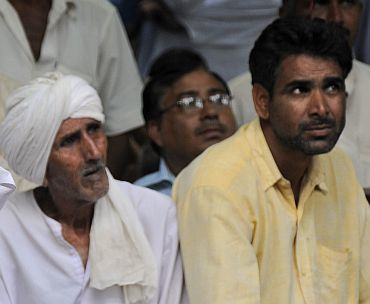 Members of the Jat community listen to a speech