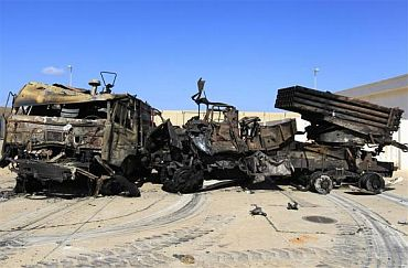 Destroyed military vehicles are seen at a naval military facility after coalition air strikes in People's Port in eastern Tripoli