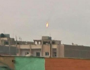 A fighter jet bursts into flames after being shot down over the rebel-held Libyan city of Benghazi
