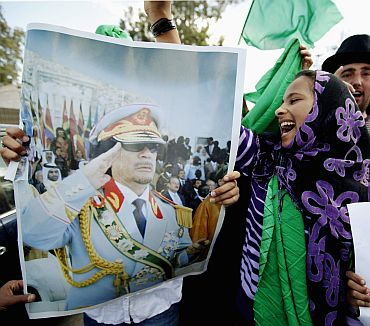 A supporter of Libya's leader Muammar Gaddafi shouts during a protest in Tripoli