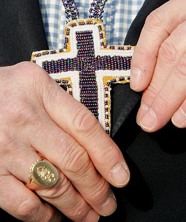 Primate of Anglican Church of Canada Most Revd Sandford Hutchison displays crucifix in Ireland