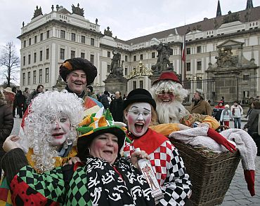 Revellers in fancy dress parade in front of Prague Castle in Prague, capital of Czech Republic