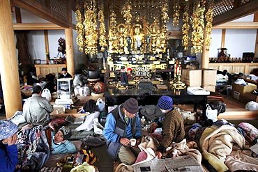 Tsunami victims find shelter in a Buddhist temple in Kesennum