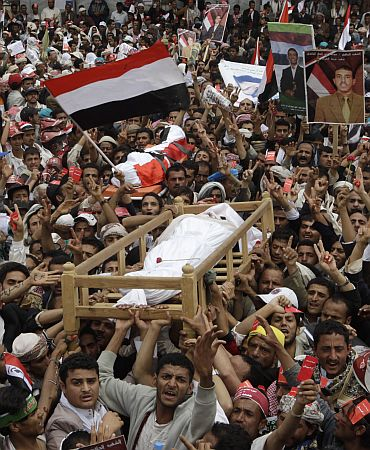 Anti-government protesters, demanding the resignation of Yemeni President Saleh, during funeral procession in Sanaa University on Friday