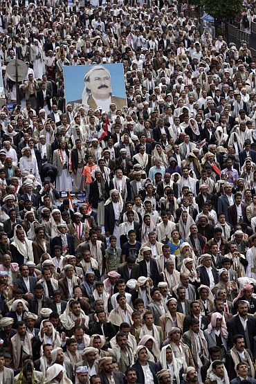 Supporters of Yemen's President Ali Abdullah Saleh attend Friday prayers during a counter-rally in Sanaa