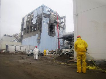 Handout photograph shows efforts to spray water into the No. 4 reactor at the Fukushima Daiichi Nuclear Power Plant in northeastern Japan