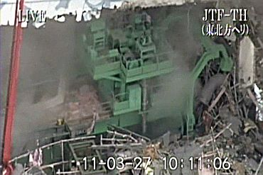 A handout from Japan Ground Self-Defense Force via Kyodo shows No. 4 reactor at Tokyo Electric Power Co.'s Fukushima Daiichi Nuclear Power Plant