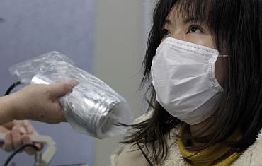 Rie Imai, who was evacuated from Minamisoma in Fukushima, undergoes a test for signs of nuclear radiation at a health centre in Yonezawa