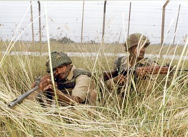 Indian soldiers keep vigil on the Indo-Pak border