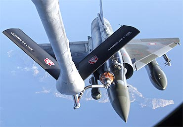 A French Mirage 2000 fighter jet refuels with an airborne Boeing C135 refuelling tanker aircraft. France continues it military air sorties over Libya with NATO indicating the no fly zone operation could last three months