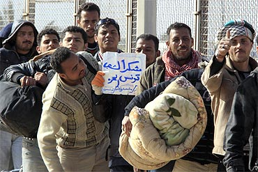 Egyptians who fled Libya a few days ago queue to board a plane heading for Egypt
