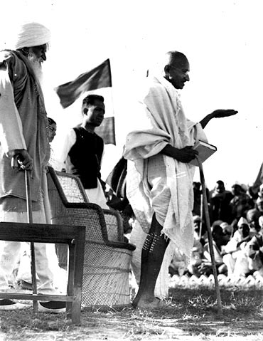 Mahatma Gandhi speaking at a rally.