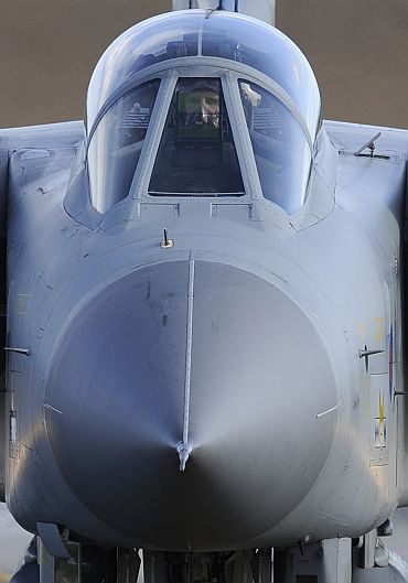 The pilot of a Royal Air Force Tornado jet taxis along the runway at RAF Lossiemouth in Moray, northern Scotland