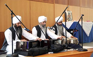 Bhai Harmohan Singh and his brothers sing hymns at the memorial