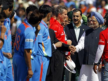 PM Singh and Pak PM Gilani meet with match official Billy Bowden (in red) and Indian players ahead of the ICC Cricket World Cup semi-final match