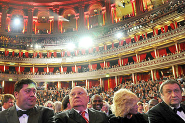Former Soviet President Mikhail Gorbachev sits with his daughter Irina during the concert in his honour, at the Royal Albert Hall in London