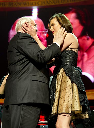 Mikhail Gorbachev and supermodel Mila Jovovich embrace on stage during the finale of the Gorby 80 Gala
