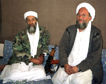 Osama bin Laden sits with Ayman al-Zawahiri
