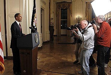 Photographers take pictures of US President Barack Obama after he announced Laden's death