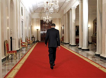 US President Barack Obama walks down the Cross Hall of the White House after announcing the death of Osama bin Laden