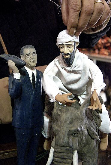 Figurines depicting bin Laden escaping from  Afghan and Bush holding an atomic bomb