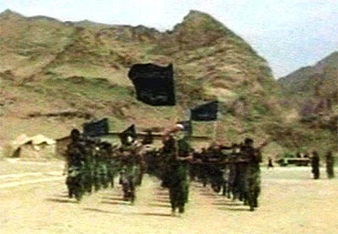 An Al Qaeda faction can be seen marching in this frame grab