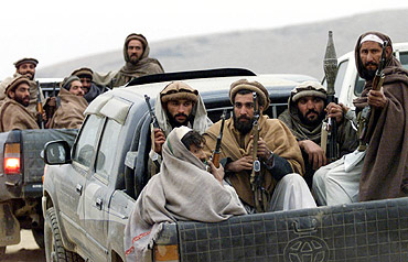 Afghan fighters in the Tora Bora mountains, December 16, 2001. Laden was believed to have escaped into Pakistan's tribal areas through this area of Afghanistan
