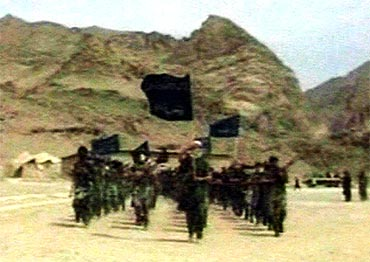 Recruits of Osama bin Laden are seen marching in this frame grab from an undated training video at an undisclosed location in Afghanistan