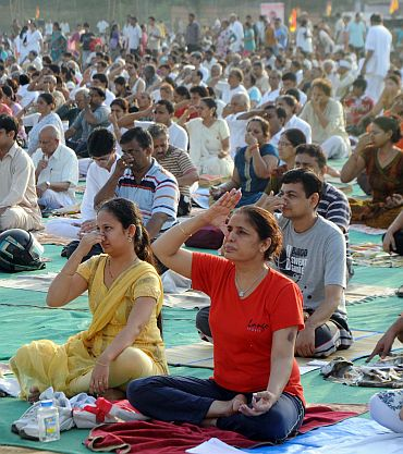 In PHOTOS: Baba Ramdev teaches yoga in Mumbai - Rediff com News