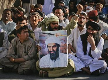 Supporters of al-Qaeda leader Osama bin Laden shout anti-American slogans, after the news of his death, during a rally in Quetta