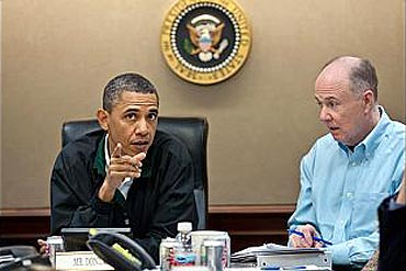 Obama discusses the operation with US National Security Advisor Tom Donilon at the White House