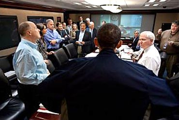 Obama talks with members of the national security team at the conclusion of one in a series of meetings discussing the mission against Osama bin Laden, in the Situation Room of the White House