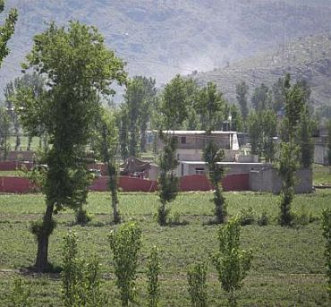 Surrounded in red fabric, a compound is seen where locals reported a firefight took place overnight in Abbotabad