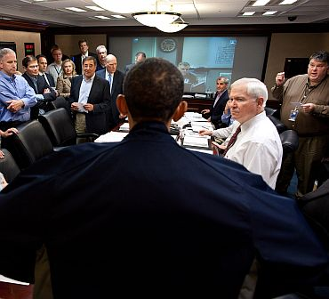 President Barack Obama talks with members of the national security team