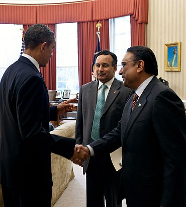 President Barack Obama meets with President Asif Ali Zardari of Pakistan, right, and Husain Haqqani, Pakistan's ambassador to the United States, centre, in the Oval Office
