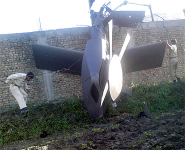 Part of a damaged helicopter used by US Navy SEALs lying in bin Laden's compund in Abbottabad