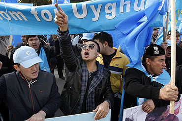 Uyghur demonstrators protest outside China's consulate in Melbourne