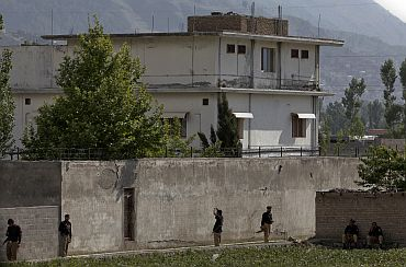 Pakistani security personnel surrounding the compound where Al Qaeda leader Osama bin Laden was killed in Abbottabad