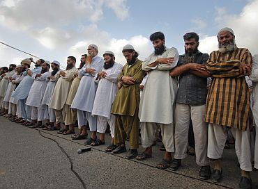 Supporters of banned Jamaat-ud-Dawa weep as they take part in a funeral prayer for Osama in Karachi