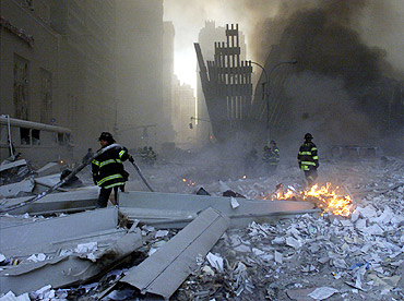 Firemen work around the World Trade Center after both towers collapsed in New York on September 11, 2001, in a terror attack