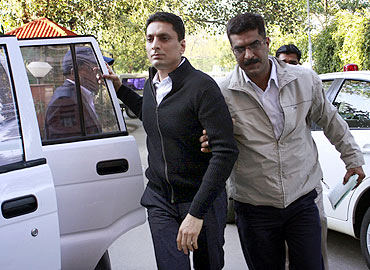 CBI officials escort Shahid Balwa at the CBI headquarters in New Delhi