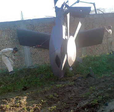 Part of a damaged helicopter is seen lying near the compound after US Navy SEAL commandos killed Al Qaeda leader Osama bin Laden in Abbottabad
