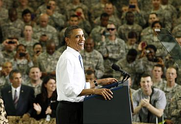 President Obama smiles as he arrives to speak to troops at Fort Campbell in Kentucky