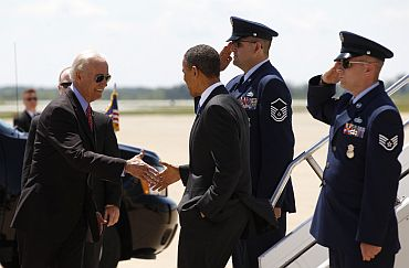 President Obama is greeted by Vice President Joe Biden as he arrives to speak to troops at Fort Campbell in Kentucky