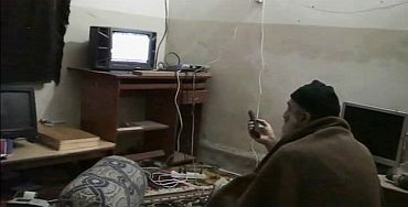 Osama bin Laden is shown watching himself on television in this video frame grab released by the US