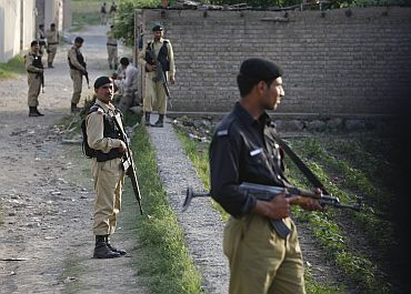 Pakistan Army soldiers keep guard outside bin Laden's compound