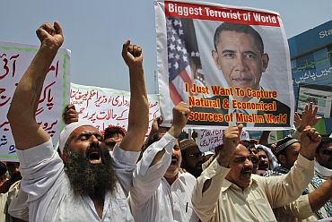 Activists of social group Muthahida Shehri Mahaz shout anti-US protests condemning Osama's killing