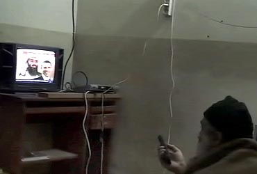 Bin Laden is shown watching himself on television, with US President Barack Obama also on screen, in this video frame grab released by the US Pentagon